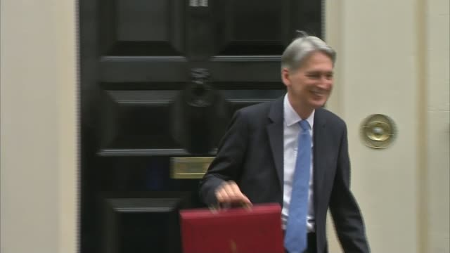 Chancellor Philip Hammond delivers Budget speech Various of Hammond away to car PHOTOGRAPHY****
