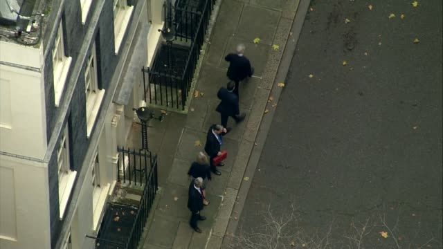 Chancellor Philip Hammond delivers Budget speech AIR VIEW / AERIAL Treasury MPs leave Hammond to pose alone on the doorstep of Number 11