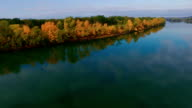 Autumn forest on the riverbank. Fall landscape. Aerial view