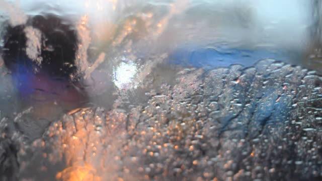 Autumn rain water drops on glass surface