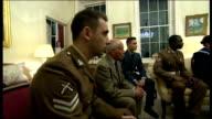 George Osborne photocall with military family representatives ENGLAND London HM Treasury INT George Osborne MP sitting and chatting with...
