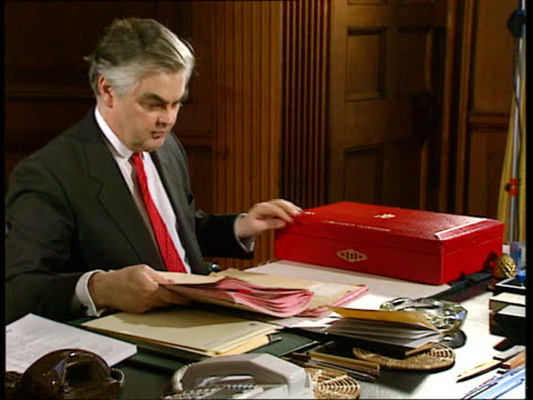 Autumn statement London INT SEQ Chancellor Norman Lamont MP seated at desk with red despatch box ITN
