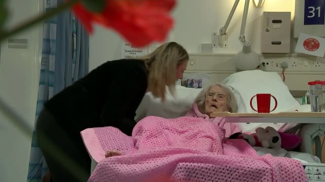 NHS and social care ENGLAND Birmingham Queen Elizabeth Hospital INT GVs Monica Byrne visiting her elderly mother Anna on ward Monica Byrne at...