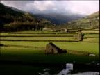 Autumn sun rises over stone houses and farmland
