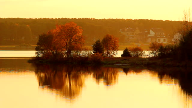 Autumn sunrise on lake