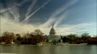 Autumn trees surround the United States Capitol. Available in HD.