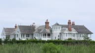 Available properties are seen in Southampton NY July 23 2017 Photographer Timothy Fadek Shots shot of trees obscuring luxury home wide shot of home...