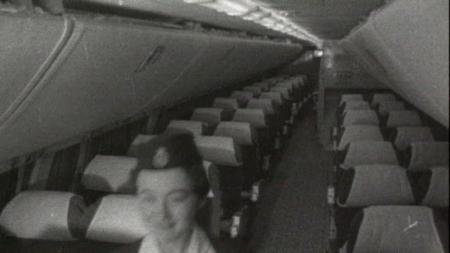 British Airways record loss ** Frank Sinatra music overlaid ** b/w footage interior of areoplane airline staff preparing food and passenger putting...