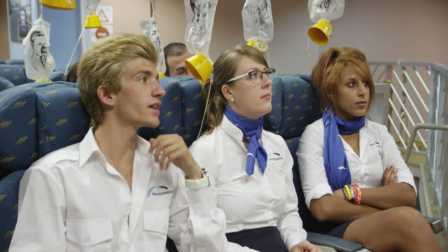 LA MS aviation cabin crew training class, trainees answering teacher (out of frame), RED R3D 4k