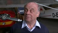 Germanwings plane crash Police search homes of Andreas Lubitz INT Ernst Muller and reporter along in hangar Muller speaking to press Ernst Muller...