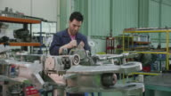 DS WS aviation mechanic trainee at work on aircraft components  in the workshop of a training facility, RED R3D 4k