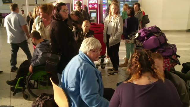 Monarch Airlines folds overnight leaving thousands stranded West Sussex Gatwick Airport INT Various shots group of people stranded at airport Alan...