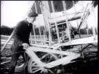 Aviation pioneer Wilbur Wright w/ unidentifed men ZI Wilbur LE MANS FRANCE VS Wilbur amp men preparing aircraft mounting on catapult turning...