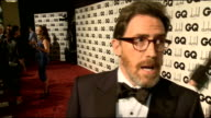 Arrivals and interviews ENGLAND London Royal Opera House INT GVs Celebrities chatting to press on red carpet including comedian Rob Brydon and Kelly...