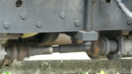 axle under the car , close up