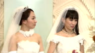 Ayaka Ichinose a 34yearold TV personality and her partner actress and dancer Akane Sugimori hold their wedding ceremony in Tokyo's Shinjuku Ward on...