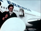 Ayatollah Ruhollah Khomeini descends aeroplane steps and is surrounded by crowd of supporters on his return to Iran after 15 years in exile 1...