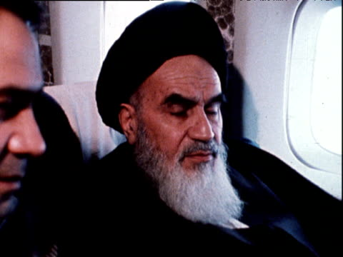 Ayatollah Ruhollah Khomeini seated in plane returning to Iran after 15 years in exile 1 Feb 79