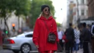 Aylin Koenig wears a black beanie hat sunglasses a red hoodie a Vuitton bag red plastic pants outside Topshop during London Fashion Week September...