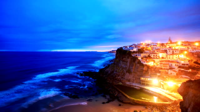 Azenhas do Mar village at dusk with stormy, Sintra Portugal
