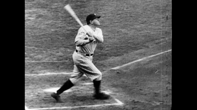 Babe Ruth hits the first home run in AllStar Game history during the inaugural game at Chicago's Comiskey Park / crowds standing in stadium to watch...