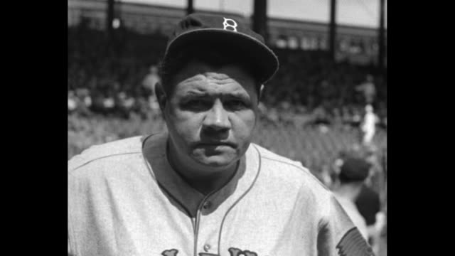 CU Babe Ruth wearing Boston Braves uniform stands on Polo Grounds field and comments on it being nice to be back in New York