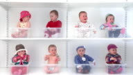 8 babies on shelves in various outfits.