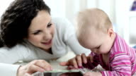 HD: Baby and mother with tablet