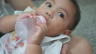 Baby Bottle Feeding and lying down on mother lap