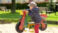Baby boy having fun in the playground