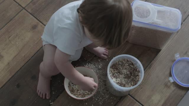 Baby Boy Making A Messy Breakfast