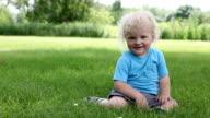 Baby boy playful on grass