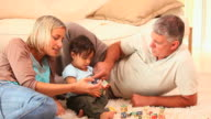 Baby discovering blocks with his parents / Cape Town, Western Cape, South Africa