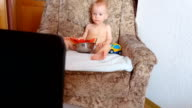 Baby eating watermelon, playing and watching cartoons