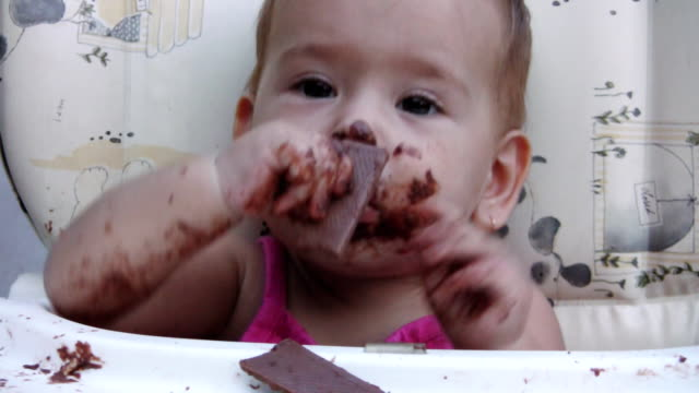 Baby girl and chocolate (HD)