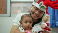 Baby Girl and mother with Christmas concept