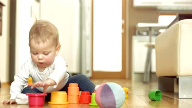 Baby Girl Exploring Block Toys