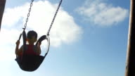 Baby girl having fun on the swing