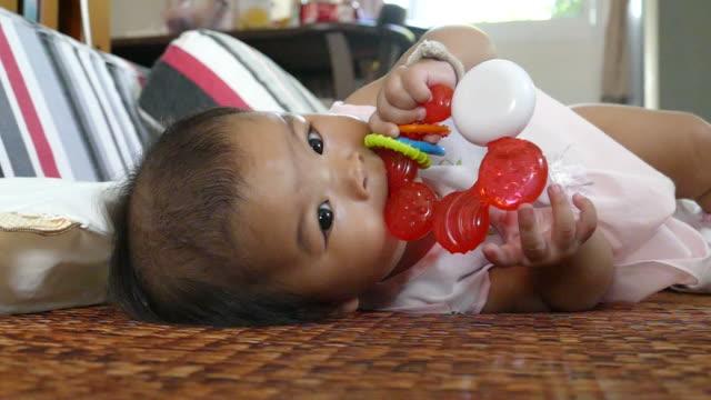 Baby girl laying on carpet