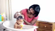 HD: Baby in Bath having her hair washed