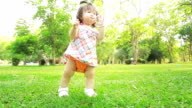 Baby on grass, dolly shot.