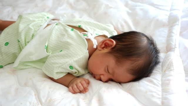 Baby sleep on his bed