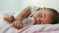Baby sleep while drinking milk bottle