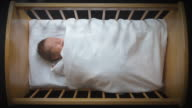 OH MS Baby sleeping in crib under white blanket/ Auckland, New Zealand