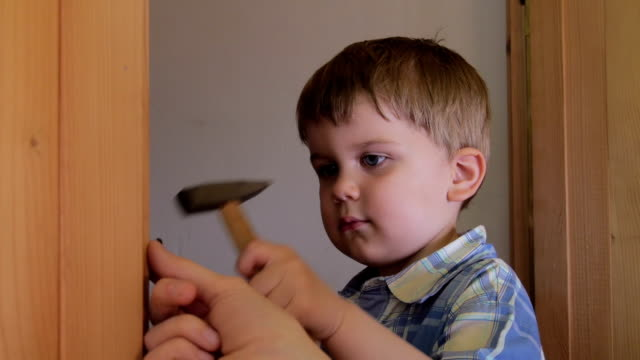 Baby using hammer