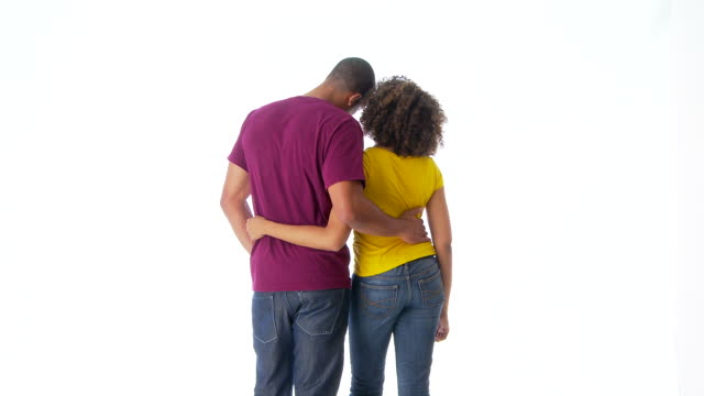 Back of couple holding each other