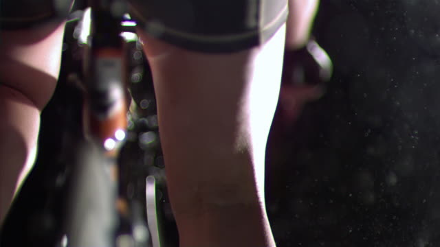 CU SLO MO PAN Back of female athlete legs on racing bicycle / Los Angeles, California, United States