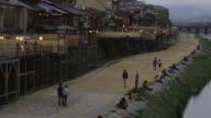 WS HA Back part of Pontocho alley and promenade at Kamo River at dusk, Kyoto, Japan