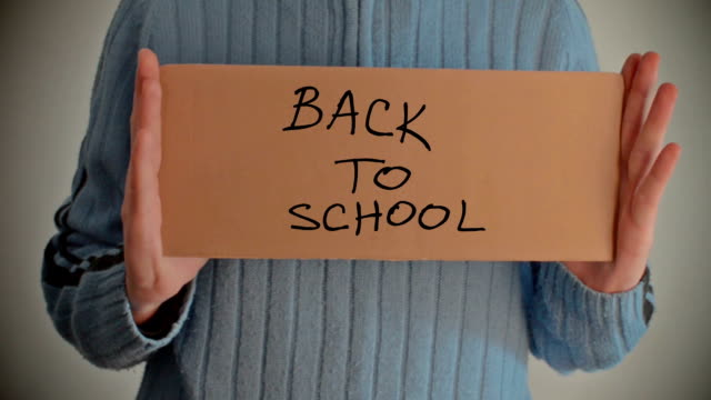 Back to School message on cardboard