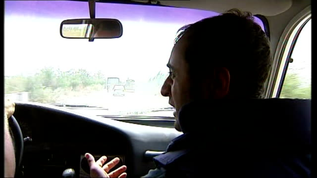 Back View Alexander Machevsky interview as along in car SOT talking of Russian plans POV shot through front windscreen of car as along in convoy EXT...